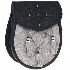 Semi Dress Sporran Pouch SSD16 This sporran has a beautifully embossed celtic upper flap design with five inserted studs. Sporran features include: Hand made in Scotland