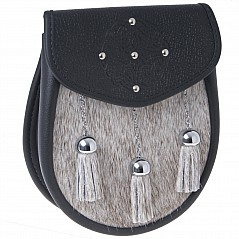 Semi Dress Sporran Pouch SSD3 This sporran has a beautifully embossed celtic upper flap design with five inserted studs. Sporran features include: Hand made in Scotland 100%