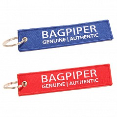 The Bagpiper Name Tag Keyring. Can be attached to your bagpipe case for name identification (just write your name on the back of the keyring). Material: embroidered cloth