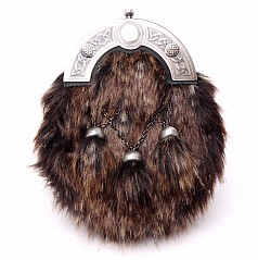 The ornate celtic cantle top design and immitation kodiak fur create a beautiful finish to this already unique sporran pouch style. Sporran features include: Hand made in Scotland